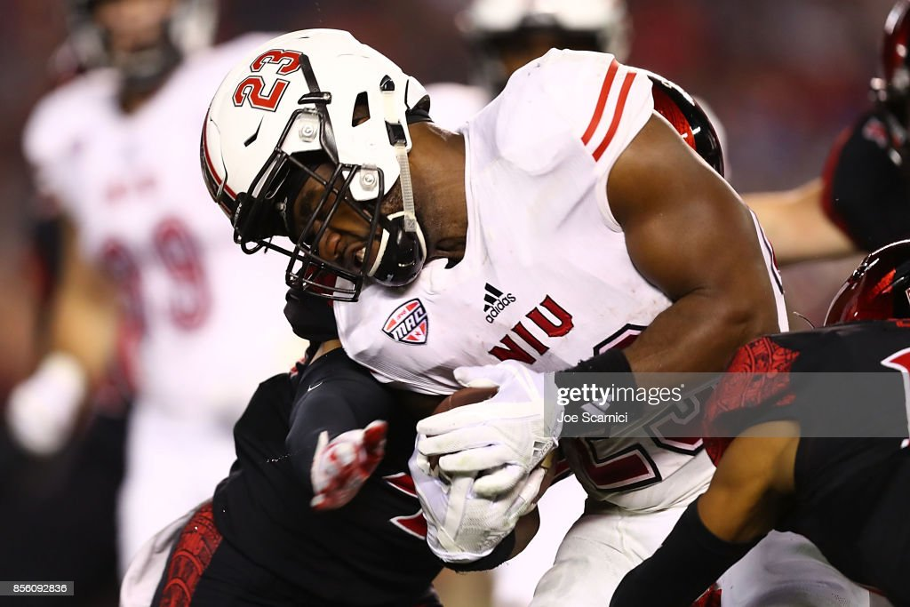 Jordan Huff #23 of the Northern Illinois Huskies is tackled in the first quarter during the Northern Illinois v San Diego State game at Qualcomm Stadium on September 30, 2017 in San Diego, California.