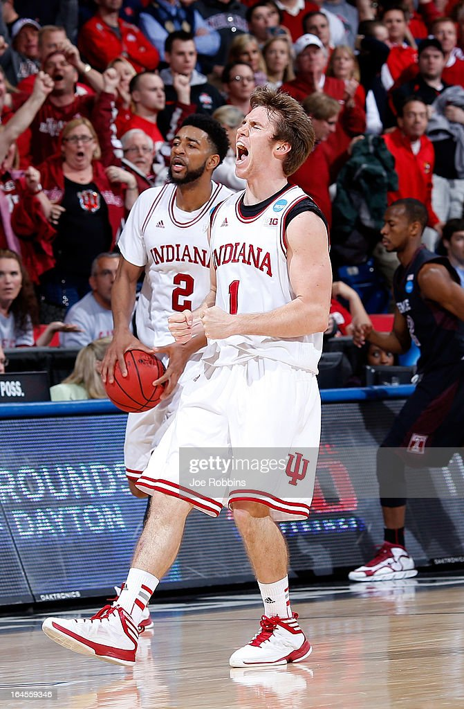 Jordan Hulls #1 and Christian Watford #2 of the Indiana Hoosiers celebrate late in the game against the Temple Owls during the third round of the 2013 NCAA Men's Basketball Tournament at UD Arena on March 24, 2013 in Dayton, Ohio.