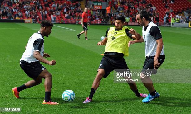 Jordan Ibe and Emre Can of Liverpool in action during a training session at Anfield on August 8 2014 in Liverpool England