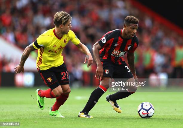Jordan Ibe of AFC Bournemouth attempts to get past Kiko Femenia of Watford during the Premier League match between AFC Bournemouth and Watford at...