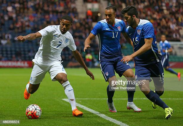 Jordan Ibe of England takes on Jerome Kiesewetter of USA centre and Eric Miller of USA right during the International friendly match between England...