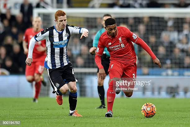 Jordan Ibe of Liverpool competes with Jack Colback of Newcastle United during the Barclays Premier League match between Newcastle United and...