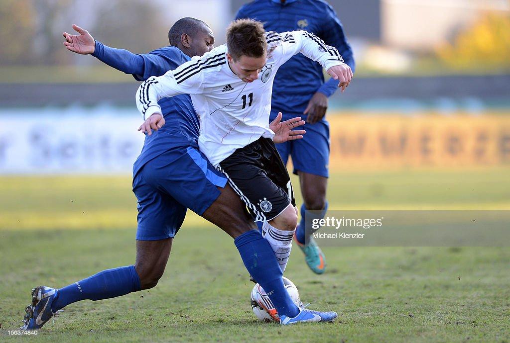 Jordan Ikoko (l) of France challenges Thomas Pledl during the International Friendly match between U19 Germany and U19 France at Rheinstadium on November 14, 2012 in Kehl, Germany.