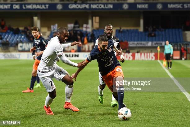 Jordan Ikoko of Guingamp and Ryad Boudebouz of Montpellier during the French Ligue 1 match between Montpellier and Guingamp at Stade de la Mosson on...