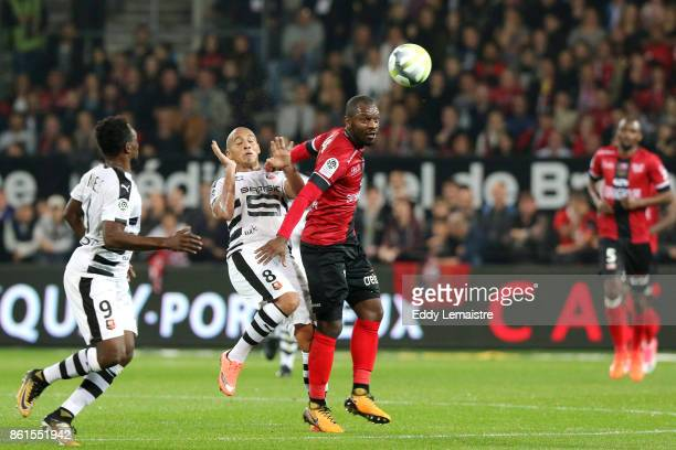 Jordan Ikoko of Guingamp and Wahbi Khazri of Rennes during the Ligue 1 match between EA Guingamp and Stade Rennais at Stade du Roudourou on October...