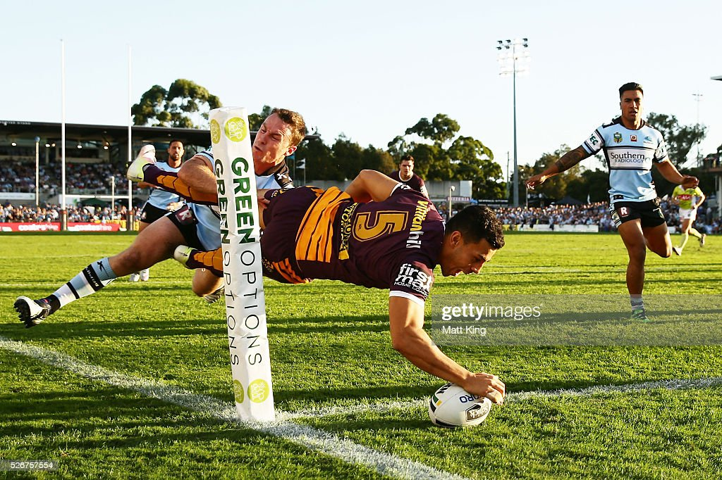 Jordan Kahu of the Broncos beats James Maloney of the Sharks to score in the corner during the round nine NRL match between the Cronulla Sharks and the Brisbane Broncos at Southern Cross Group Stadium on May 1, 2016 in Sydney, Australia.