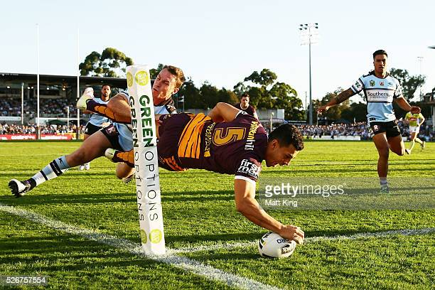 Jordan Kahu of the Broncos beats James Maloney of the Sharks to score in the corner during the round nine NRL match between the Cronulla Sharks and...