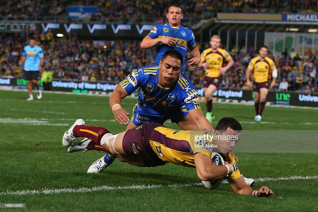 Jordan Kahu of the Broncos dives over to score a try during the round nine NRL match between the Parramatta Eels and the Brisbane Broncos at Parramatta Stadium on May 11, 2013 in Sydney, Australia.
