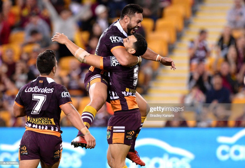 Jordan Kahu of the Broncos is congratulated by team mates after scoring a try during the round nine NRL match between the Brisbane Broncos and the Penrith Panthers at Suncorp Stadium on April 27, 2017 in Brisbane, Australia.