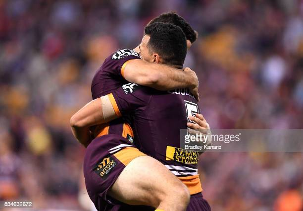 Jordan Kahu of the Broncos is congratulated by team mates after scoring a try during the round 24 NRL match between the Brisbane Broncos and the St...