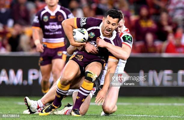 Jordan Kahu of the Broncos is tackled during the round 24 NRL match between the Brisbane Broncos and the St George Illawarra Dragons at Suncorp...
