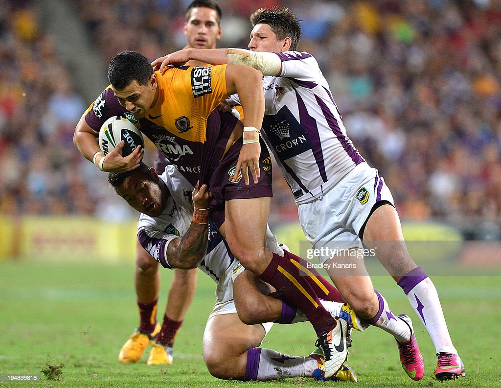 Jordan Kahu of the Broncos is tackled during the round four NRL match between the Brisbane Broncos and the Melbourne Storm at Suncorp Stadium on March 29, 2013 in Brisbane, Australia.