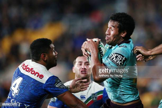 Jordan Kahu of the Broncos takes the high ball against David Fusitu'a of the Warriors during the round 12 NRL match between the New Zealand Warriors...