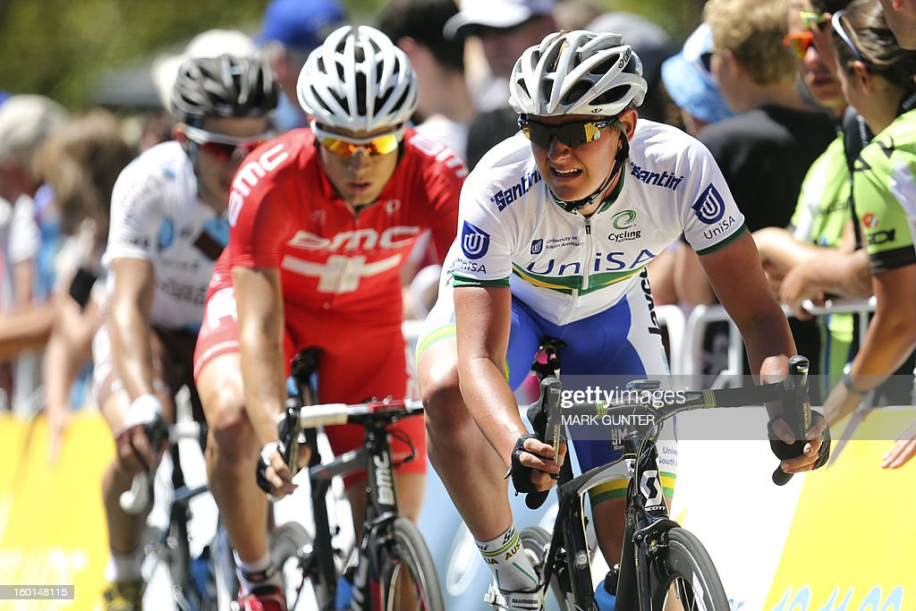 Jordan Kerby (R) of Australia leads Martin Kohler (C) of Switzerland during the 90-km stage 6 around the streets of Adelaide on the final day of the Tour Down Under cycling race on January 27, 2013. AFP PHOTO / Mark Gunter USE