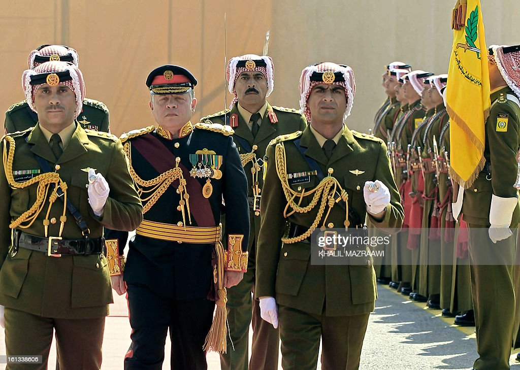 Jordan King Abdullah II (2L) reviews the honor guard prior to addressing the opening of the Jordanian parliament in the capital Amman on February 10, 2013. King Abdullah told newly elected members of parliament that he seeks to reach 'consensus' with them before naming a prime minister, and hailed the 'historic transformation' towards parliamentary government in Jordan.