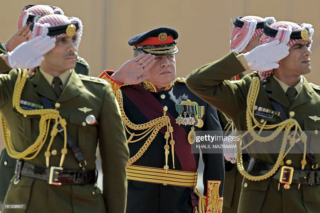 Jordan King Abdullah II (C) reviews the honor guard prior to addressing the opening of the Jordanian parliament in the capital Amman on February 10, 2013. King Abdullah told newly elected members of parliament that he seeks to reach 'consensus' with them before naming a prime minister, and hailed the 'historic transformation' towards parliamentary government in Jordan.