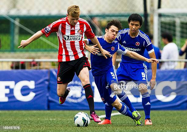 Jordan Laidler of Sunderland and Stephen Liu Gar Lock of South China fight for the ball on day three of the Hong Kong International Soccer Sevens at...