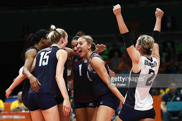 Jordan LarsonBurbach Kimberly Hill Kayla Banwarth and Foluke Akinradewo of United States celebrate a point during the Women's Bronze Medal Match...