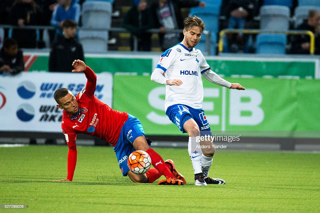 Jordan Larsson of Helsingborgs IF and Andreas Blomqvist of IFK Norrkoping competes for the ball during the Allsvenskan match between IFK Norrkoping and Helsingborgs IF at Ostgotaporten on May 2, 2016 in Norrkoping, Sweden.