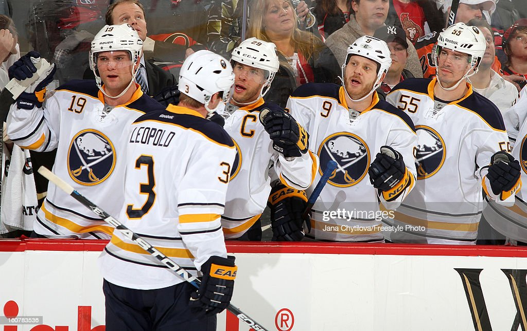 Jordan Leopold #3 of the Buffalo Sabres celebrates a first period goal with teammates Cody Hodgson #19, Jason Pominville #29, Steve Ott #9 and Jochen Hecht #55, during an NHL game against the Ottawa Senators at Scotiabank Place on February 5, 2013 in Ottawa, Ontario, Canada.