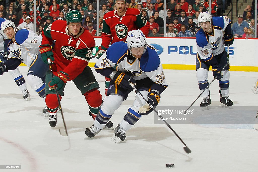 <a gi-track='captionPersonalityLinkClicked' href=/galleries/search?phrase=Jordan+Leopold&family=editorial&specificpeople=201885 ng-click='$event.stopPropagation()'>Jordan Leopold</a> #33 of the St. Louis Blues skates with the puck while <a gi-track='captionPersonalityLinkClicked' href=/galleries/search?phrase=Ryan+Suter&family=editorial&specificpeople=583306 ng-click='$event.stopPropagation()'>Ryan Suter</a> #20 of the Minnesota Wild defends during the game on April 1, 2013 at the Xcel Energy Center in Saint Paul, Minnesota.