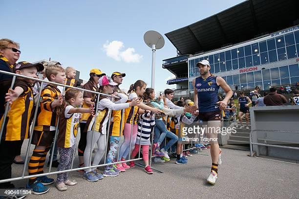 Jordan Lewis acknowledges the fans before a Hawthorn Hawks AFL training session at Waverley Park on September 29 2015 in Melbourne Australia