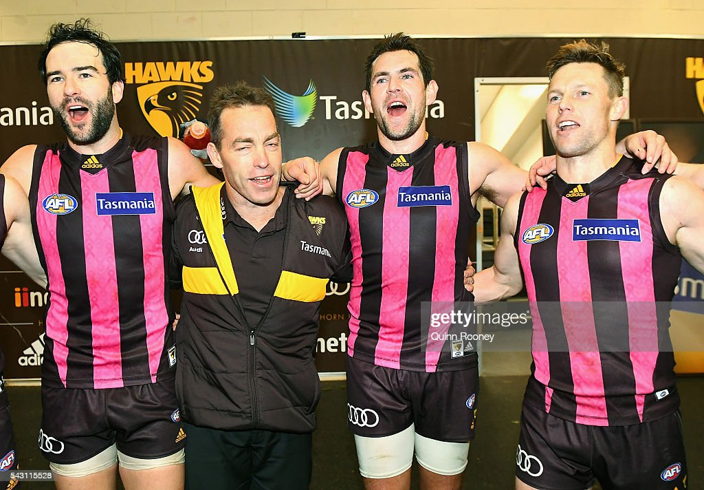 Jordan Lewis, Alastair Clarkson, Luke Hodge and Sam Mitchell of the Hawks sing the song in the rooms after winning the round 14 AFL match between the Hawthorn Hawks and the Gold Coast Suns at Aurora Stadium on June 26, 2016 in Launceston, Australia.
