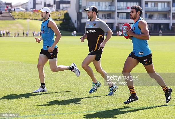 Jordan Lewis and Cyril Rioli of the Hawks take part in 100 metre stride throughs during a Hawthorn Hawks AFL media session at Waverley Park on...