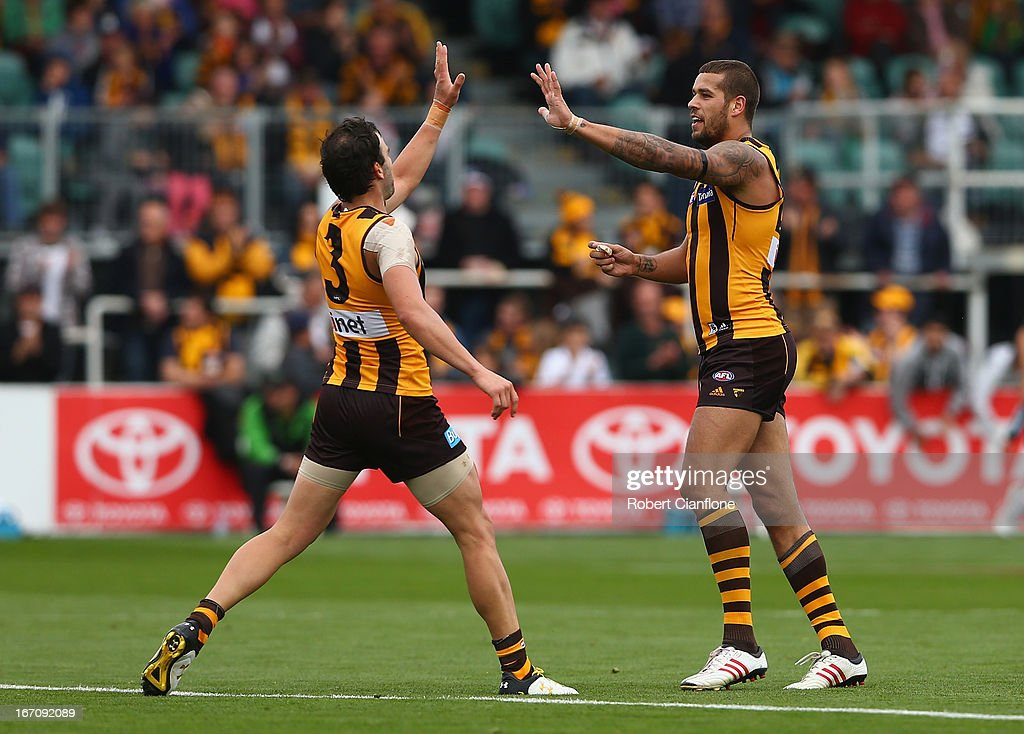 Jordan Lewis and Lance Franklin of the Hawks celebrate a goal during the round four AFL match between the Hawthorn Hawks and the Fremantle Dockers at Aurora Stadium on April 20, 2013 in Launceston, Australia.