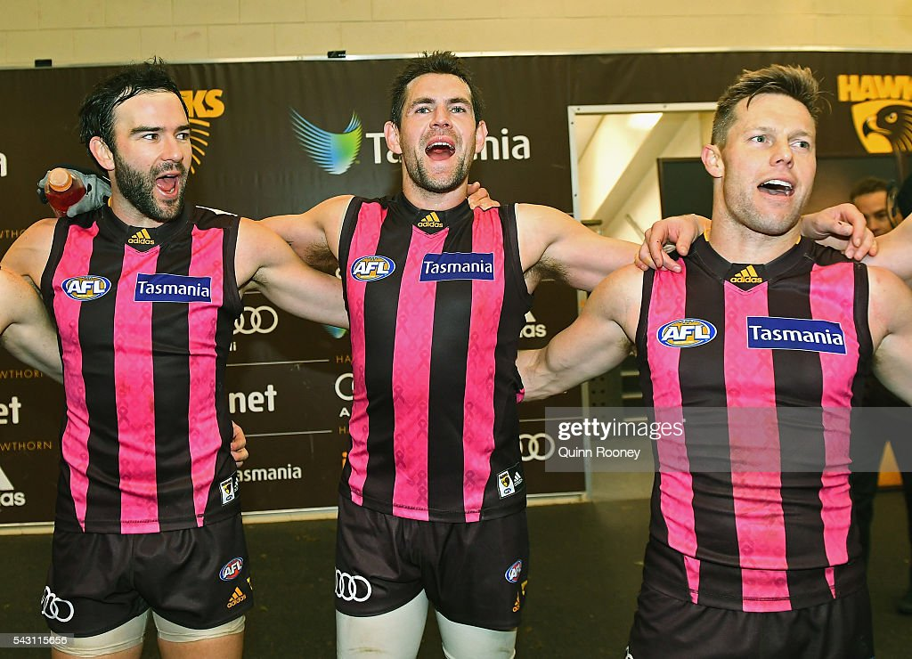 Jordan Lewis, Luke Hodge and Sam Mitchell of the Hawks sing the song in the rooms after winning the round 14 AFL match between the Hawthorn Hawks and the Gold Coast Suns at Aurora Stadium on June 26, 2016 in Launceston, Australia.
