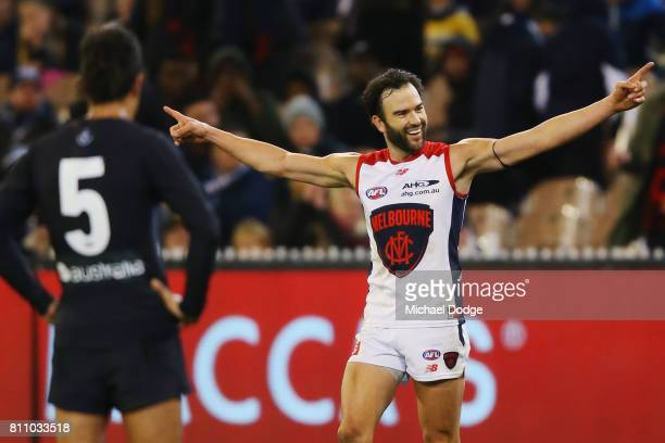 Jordan Lewis of the Demons celebrates a goal after the final siren during the round 16 AFL match between the Carlton Blues and the Melbourne Demons...