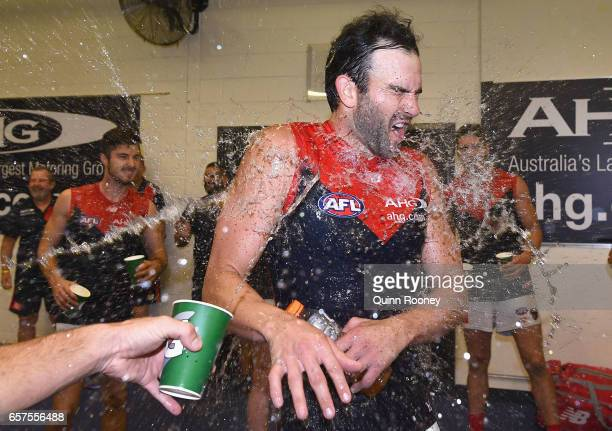 Jordan Lewis of the Demons is sprayed with drinks in the rooms after the Demons won the round one AFL match between the St Kilda Saints and the...