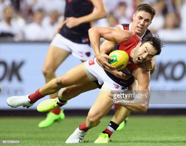 Jordan Lewis of the Demons is tackled by Jade Gresham of the Saints during the round one AFL match between the St Kilda Saints and the Melbourne...