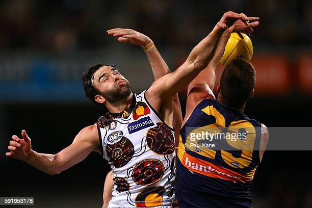 Jordan Lewis of the Hawks and Scott Lycett of the Eagles contest for the ball during the round 22 AFL match between the West Coast Eagles and the...
