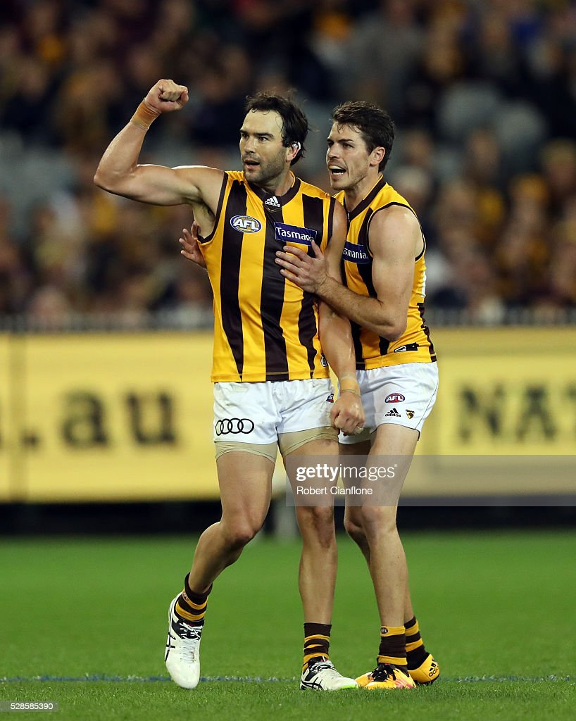 <a gi-track='captionPersonalityLinkClicked' href=/galleries/search?phrase=Jordan+Lewis&family=editorial&specificpeople=236095 ng-click='$event.stopPropagation()'>Jordan Lewis</a> of the Hawks celebrates a goal with Isaac Smith during the round seven AFL match between the Richmond Tigers and the Hawthorn Hawks at Melbourne Cricket Ground on May 6, 2016 in Melbourne, Australia.