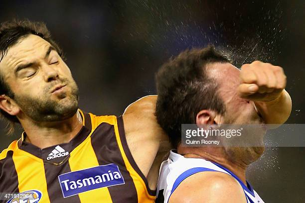 Jordan Lewis of the Hawks collects Todd Goldstein of the Kangaroos in the head as he attempts to spoil during the round five AFL match between the...
