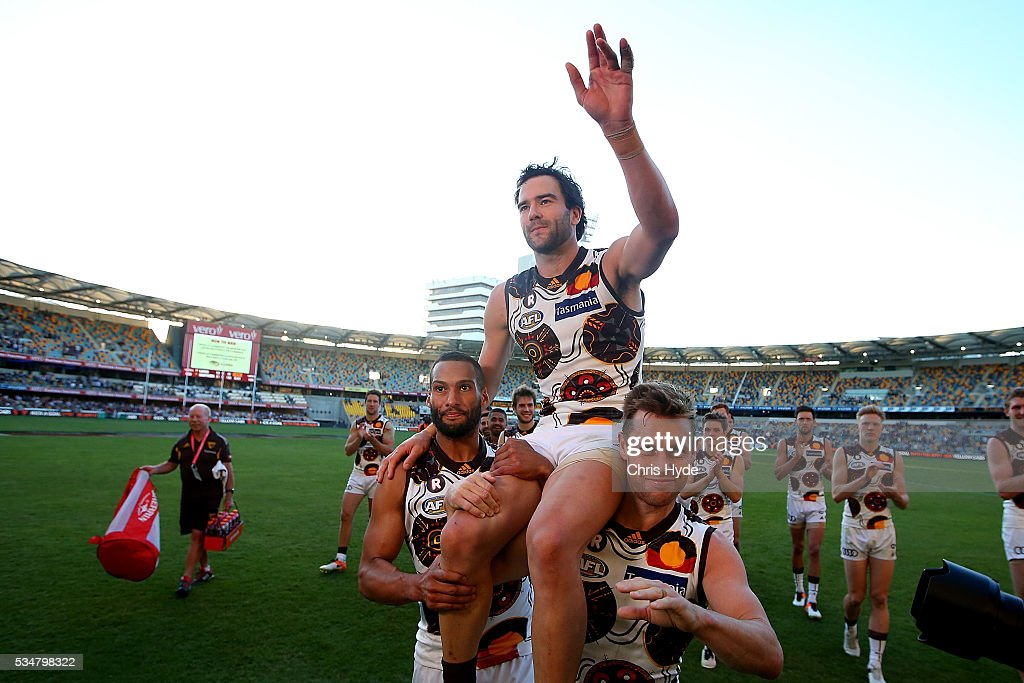 <a gi-track='captionPersonalityLinkClicked' href=/galleries/search?phrase=Jordan+Lewis&family=editorial&specificpeople=236095 ng-click='$event.stopPropagation()'>Jordan Lewis</a> of the Hawks is chaired from the field after his 250th match during the round 10 AFL match between the Brisbane Lions and the Hawthorn Hawks at The Gabba on May 28, 2016 in Brisbane, Australia.