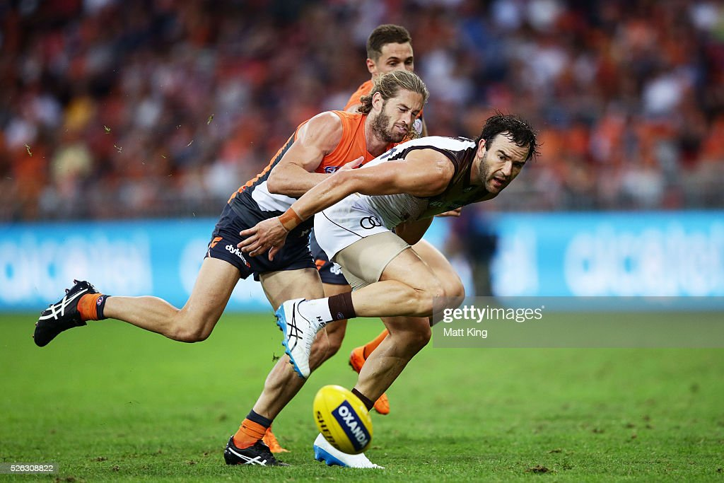 <a gi-track='captionPersonalityLinkClicked' href=/galleries/search?phrase=Jordan+Lewis&family=editorial&specificpeople=236095 ng-click='$event.stopPropagation()'>Jordan Lewis</a> of the Hawks is challenged by Callan Ward of the Giants during the round six AFL match between the Greater Western Sydney Giants and the Hawthorn Hawks at Spotless Stadium on April 30, 2016 in Sydney, Australia.