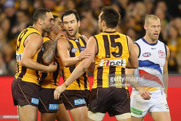 Jordan Lewis of the Hawks is congratulated by team mates after kicking a goal during the Second AFL Semi Final match between the Hawthorn Hawks and...