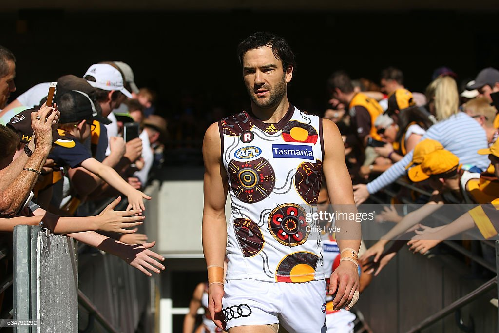 <a gi-track='captionPersonalityLinkClicked' href=/galleries/search?phrase=Jordan+Lewis&family=editorial&specificpeople=236095 ng-click='$event.stopPropagation()'>Jordan Lewis</a> of the Hawks leads the team out for the round 10 AFL match between the Brisbane Lions and the Hawthorn Hawks at The Gabba on May 28, 2016 in Brisbane, Australia.