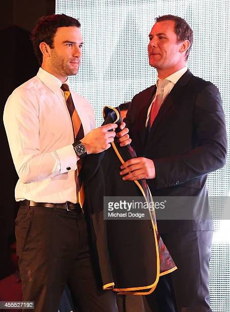 Jordan Lewis of the Hawks receives his blazer from Wayne Carey after being announced in the All Australian Team Announcement at Royal Exhibition...