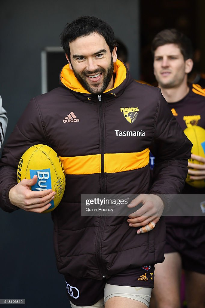 <a gi-track='captionPersonalityLinkClicked' href=/galleries/search?phrase=Jordan+Lewis&family=editorial&specificpeople=236095 ng-click='$event.stopPropagation()'>Jordan Lewis</a> of the Hawks runs out for warm up during the round 14 AFL match between the Hawthorn Hawks and the Gold Coast Suns at Aurora Stadium on June 26, 2016 in Launceston, Australia.
