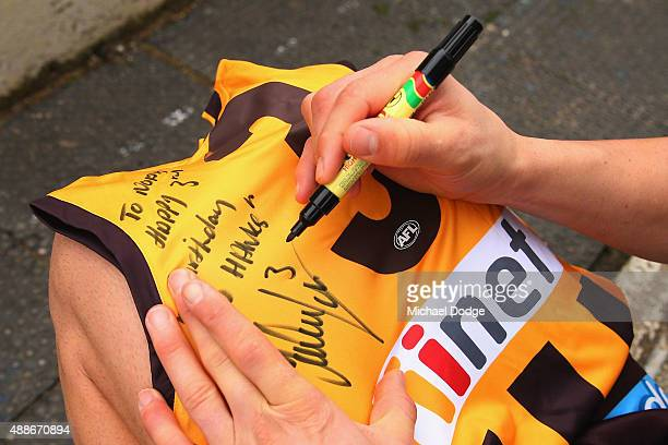 Jordan Lewis of the Hawks signs autographs for fans during a Hawthorn Hawks AFL training session at Waverley Park on September 17 2015 in Melbourne...
