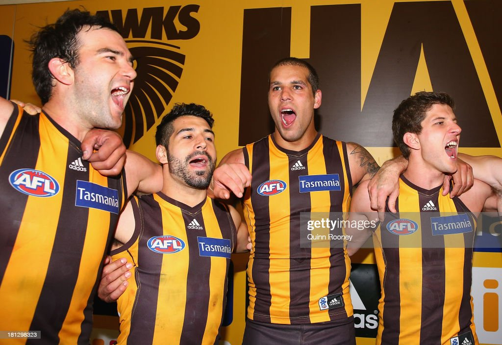 Jordan Lewis, Paul Puopolo, Lance Franklin and Luke Breust of the Hawks sing the song in the rooms after winning the AFL First Preliminary FInal match between the Hawthorn Hawks and the Geelong Cats at Melbourne Cricket Ground on September 20, 2013 in Melbourne, Australia.