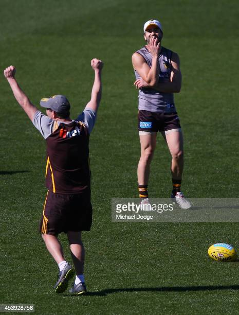 Jordan Lewis reacts as assistant coach Brett Ratten wins a skills game during a Hawthorn Hawks AFL training session at Waverley Park on August 22...