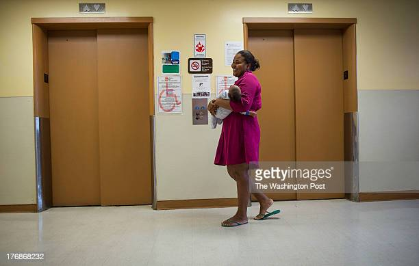 Jordan Love Smith waits for an elevator with her 2 month old son named Princeton Smith at the DC General Hospital homeless shelter on July 29 2013 in...