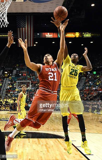 Jordan Loveridge of the Utah Utes drives to the basket against Chris Boucher of the Oregon Ducks during the championship game of the Pac12 Basketball...