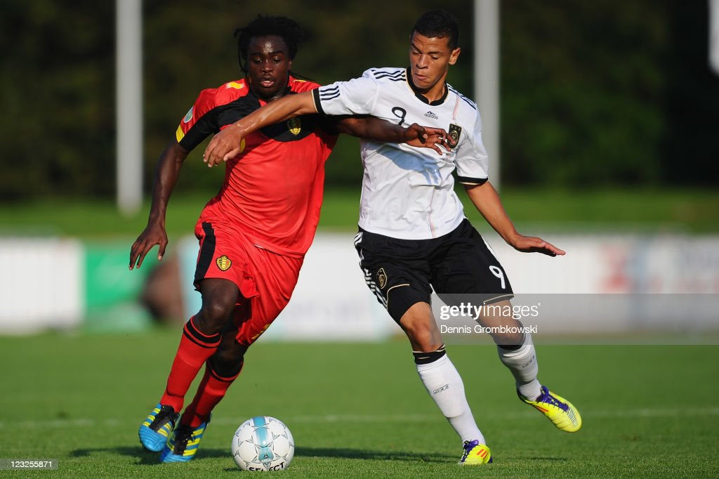 Jordan Lukaku (L) of Belgium is challenged by <a gi-track='captionPersonalityLinkClicked' href=/galleries/search?phrase=Shawn+Parker+-+Soccer+Player&family=editorial&specificpeople=5385069 ng-click='$event.stopPropagation()'>Shawn Parker</a> (R) of Germany during the U19 International friendly match between Belgium and Germany at Stade Bielmont on September 1, 2011 in Verviers, Belgium.