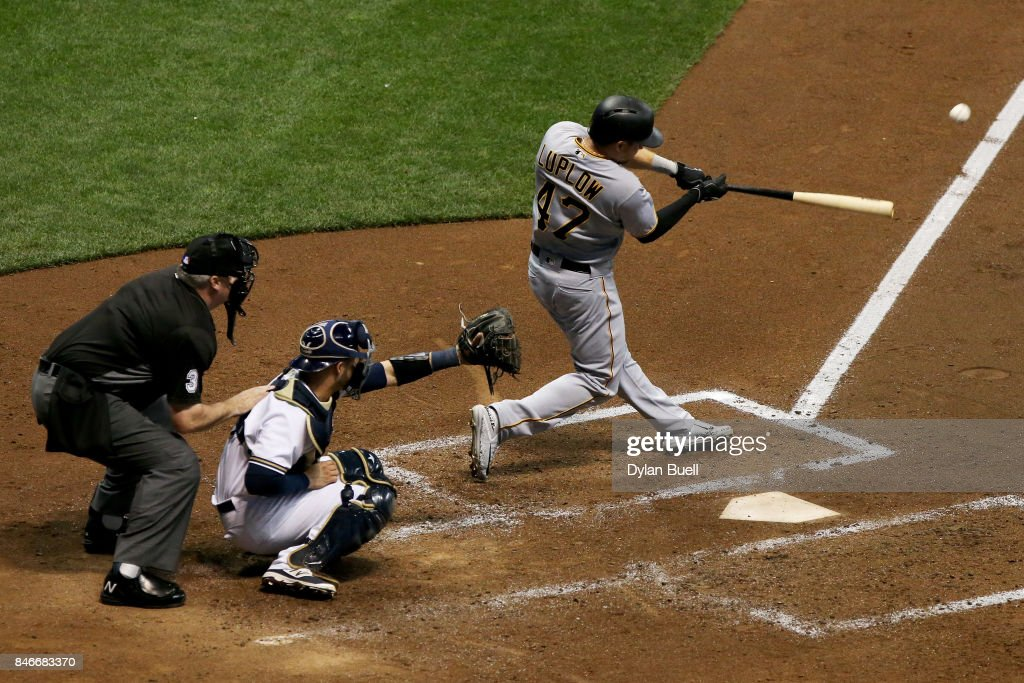 Jordan Luplow #47 of the Pittsburgh Pirates hits a double in the fourth inning against the Milwaukee Brewers at Miller Park on September 13, 2017 in Milwaukee, Wisconsin.