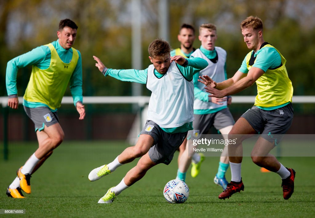 Jordan Lyden of Aston Villa in action with team mate James Bree during a training session at the club's training ground at Bodymoor Heath on October 13, 2017 in Birmingham, England.